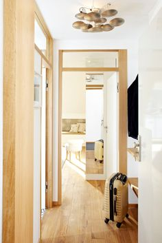 here is a great idea for small apartments: glue a small ceiling-high mirror on the side panel of your closet. The closet looks less deep and you stretch the entrance area.  Photo by BURMESTER PHOTOGRAPHY Interior Architecture & Styling UTE GÜNTHER
