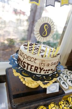 DFP mystery party cake by Scrumdiddlyumptious Bakery (Woodstock, GA) in a party by Double the Fun Parties