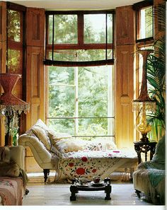 Tall plants, tall windows. Embroidered shawls. Old furniture.