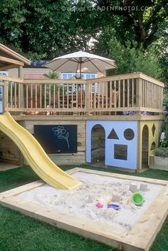 Fun home play structure under the deck...too bad our deck isn't high enough
