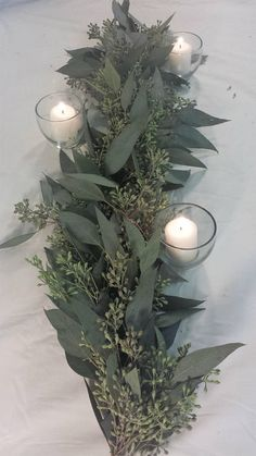 Fresh Garlands seeded eucalyptus table centerpiece