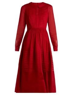 Part of Valentino's Resort 2017 collection, this cotton-organza dress arrives in a signature shade of red. Pretty details ensure a feminine finish – there's pintucks at the bib and full skirt, smocking at the waist, and a slip lining for just the right amount of coverage. Choose it over a trusted LBD, adding a tonal bag for a considered evening look.