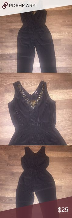 Black jumper with gold jewel designs Black polyester jumper with gold designs. Super comfy. Can be dressed up or down. Machine washable. Brought from Nordstrom Rack Pants Jumpsuits & Rompers