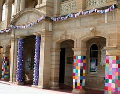 Yarnbombing columns of at town hall, by Rett Grayson