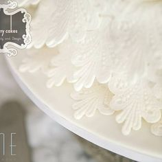 White fondant wedding cake with lace and large bow. Fondant Lace, Fondant Wedding Cakes, Lace Wedding, Cake Decorating, Bow, Tableware, Arch, Longbow, Dinnerware