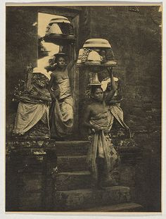 André ROOSEVELT, not titled [two Balinese women with offerings on their heads descending temple steps]