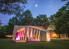 Dezeen magazine. IPT Architects creates rib cage-like pavilion using wooden frames and pink light. Installed outside the VA Museum of Childhood in east London.