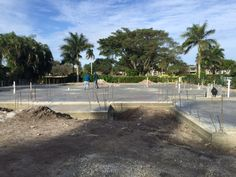 After demolition, the lot was cleared of debris and the foundational slab was poured.