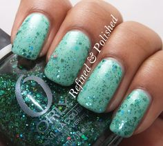 Mermaid Tale is filled with various sized green glitter, light blue hexes, and a little holo sparkle - shown over Essie Turquoise & Caicos