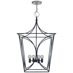 This might be a really nice way to incorporate the blue into your family room and would go nicely with the lamps.   It also comes in a larger size.  Cavanagh Medium Lantern