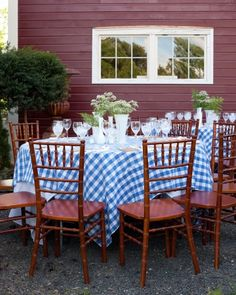 blue-and-white checkered table cloth with a mason jar in the center with white roses and purple orchids on some tables and others with white roses and blue orchids