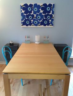 At this table they do crafts, homework, and play games! The turquiose Thonet chairs and Marimekko wall art make it fun and colorful.