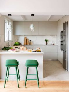 Casa Iradier by The Room Studio | green stools