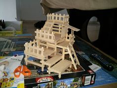 Popsicle sticks House on Behance-This is a toy house for my hamster. There is not many variety of toys for hamster, so I do some of it for my hamster Teemo. Here is a house, make of popsicle sticks, that is easy to get in any shop. You will need beside of the stick, glue for wood (non toxic), scissors and that's it! See my creation below :)