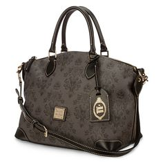 Prankish spirits are bound to inhabit our Haunted Mansion Satchel by Dooney & Bourke. The delightfully dark pattern on this fine fashion handbag is inspired by the wicked wallpaper design seen in Disney's classic attraction.