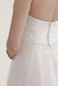 Ethereal elegance meets modern day fairy tale in this enchanting strapless tulle wedding dress!  Strapless A line gown features stunning beaded lace detail on bodice.  Softtulle skirt adds movement and is absolutely breath-taking.