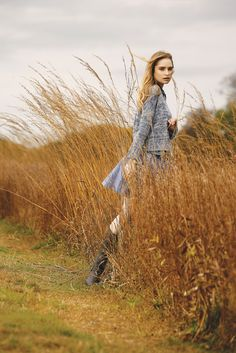 L'Agence's cotton and cashmere sweater, Ralph Lauren Denim & Supply's cotton shirt and Harvey Faircloth's cotton skirt. Hunter boots. [Photo by George Chinsee]