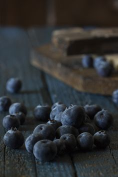 Blueberries on dark wood table by Raquel Carmona #photo #fruit