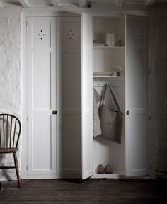 holes on frog door and pantry? The simple, functional, beautiful fitted pantry cupboard by deVOL Kitchens. Airing Cupboard, Pantry Cupboard, Cupboard Doors, Cupboard Storage, Locker Storage, Pantry Doors, Utility Cupboard, Coat Storage, Linen Cupboard