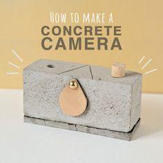 Una #fotocamera composta solo di cemento e rullino fotografico.