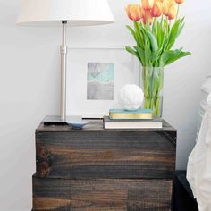 Hack wood crates with stain to transform them into a nightstand.