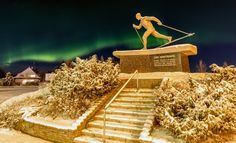 Northern lights and the statue of the Olympic winner Eero Mäntyranta at the center of Pello in Finnish Lapland