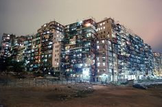 Final years of Kowloon Walled City, a notoriously overcrowded and lawless Hong Kong enclave in which 33,000 people were crammed into a monolithic structure made up of 300 tightly packed, interconnected high-rises. Girard collaborated with fellow photographer Ian Lambot during the five-year project to produce a photo book on the enclave, City of Darkness: Life in Kowloon Walled City.