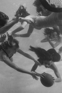 One girl getting her hair pulled as six crack swimmers play a fast scrimmage of water polo at the Athletic Club, 1947. Photo by Peter Stackpole. °