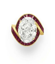 A DIAMOND AND RUBY RING   Set with a modified oval-cut diamond, weighing approximately 10.27 carats, within an overlapping calibré-cut ruby surround, mounted in 18k gold