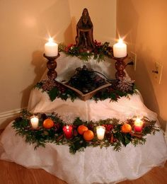 Winter solstice goddess altar 2009 -altar decorated with cedar branches, holly and berries, pine cones, cinnamon sticks, and clementines.B...