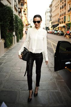 Leather leggings with tied up white blouse. Perfect!