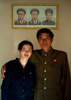 Couple in Chilbo sea - North Korea by Eric Lafforgue