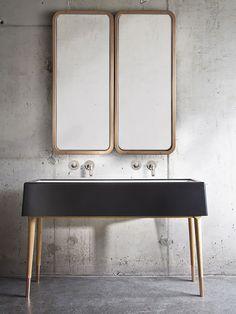 Banheiro minimalista com parede de concreto