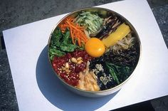 Bibimbap / Rice Mixed with Vegetables and Beef      Rice topped with various cooked vegetables, such as zucchini, mushrooms and bean sprouts, plus beef and a fried egg. Served with red chili paste, which should be mixed in thoroughly.   [Sorry, NO RECIPE]