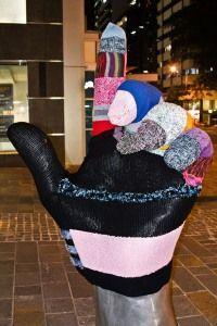 Yarn glove covers statue in Brisbane...cool