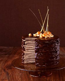 I am making this for the second time tomorrow, minus the hazelnut. It is excellent and while time consuming, it is easy to make.   Another review...I made 9 crepe high mini cakes and used a thicker ganache that got hard when chilled. AWESOME. The best ever and much easier than the larger cakes.