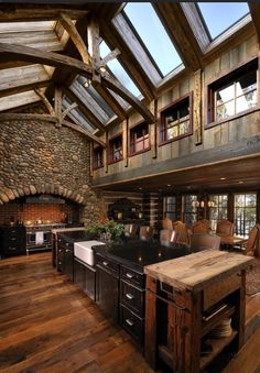 Love the dark wood and central island kitchen