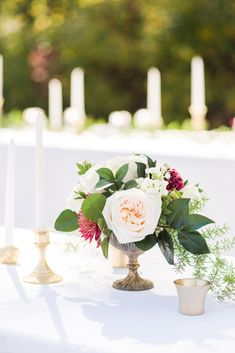 Outdoor Wedding Reception - White Table Clothes - Tall Candles with Gold Bases - Gold, White, and Maroon Wedding Maroon Wedding, Gold Wedding Theme, Wedding Details, Wedding Flowers, Wedding Hall Decorations, Gold Wedding Decorations, Wedding Theme Pictures, Mint Green Walls, Table Clothes