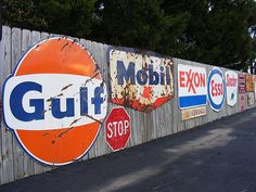 Old gas station signs by jefftowell, via Flickr