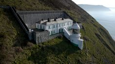 The Lighthouse Keepers' Cottage, Lynton, Devon: This unique building offers a simpler style of accommodation that is ideal for groups of walkers, birdwatchers and anyone who loves remoteness and extraordinary scenery. Devon Cottages, Lighthouse Keeper, Unique Buildings, National Trust, Home And Deco, British Isles, Pilgrimage, Architecture, Places To See