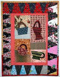 Baskets appliqued by Kathie Holland..  Quilt finished by.. ME!