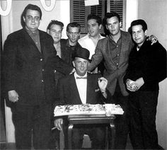 """Lamar Fike, Alan Fortas, Gene Smith, Elvis, Sonny West, Joe Esposito and Colonel Tom Parker on the set of """"Wild in the Country"""" ( Fall 1960)."""