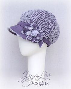 """Purple Chenille Newsboy Hat by Jaya Lee Designs This unique cap was inspired by the shell of a purple sea urchin. The hat is made from purple cotton fabric, and lined in purple linen fabric. The hat has a deep crown with a chenille like texture. Hat Size: M (22.75"""")(58cm)  Care: Hand wash cold. Air dry.  **Not sure about head size? Measure head just above the eyebrows, about mid-forehead and above the ears. (If you dont have a soft tape measure, you can use a string and then match the…"""
