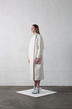 Contemporary Fashion - white coat with minimalist design exploring the theme of identity // Leonie Barth
