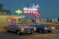 1966 Pontiac Bonneville and 1966 Chevrolet Impala SS rest along  Historic Route 66 at the Blue Swallow Motel in Tucumcari, New Mexico.