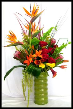 tropical arrangement - perfect in silk for coffee table - need friend w/floral skills...wait, that's me; )