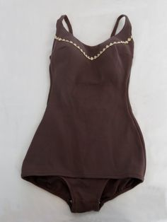 stretch nylon mushroom colored swimsuit with built in bra top and flower trim across the bust. Low, scooped back and a short skirt over the front. 1960s Fashion, Vintage Fashion, Celebrity Blogs, 1960s Outfits, Vintage Fur, Bra Tops, Short Skirts, Fashion Photo, Amelia Jane