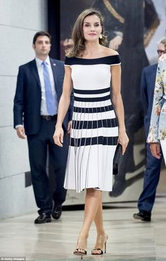 Queen Letizia of Spain looked glamorous in a black and white dress and strappy mules...