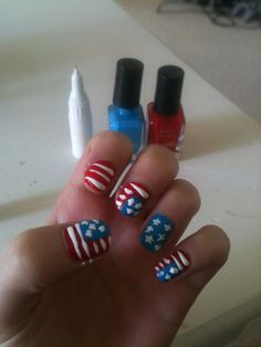 """Red, White, Blues in the sky"" I would do this but have all the nails red and white stripped and then one with blue and stars."