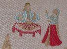 Hadji / $12.98 a yard / novelty embroidered Asian fabric